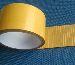 Adhesive double-sided tapes on carrier of glass fibre net - 2703
